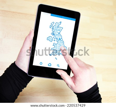 United Kingdom map and words cloud with larger cities on tablet - stock photo