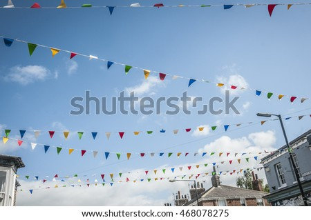 UNITED KINGDOM, YORK - AUGUST 8, 2016  Colorful festival flags above the famous Bishopthrope road in the center of York.