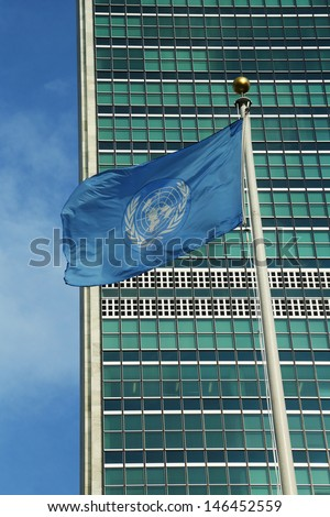 United Nations Flag in front of UN Headquarter in New York - stock photo