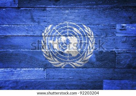 United Nations grunge flag painted on old wood background - stock photo