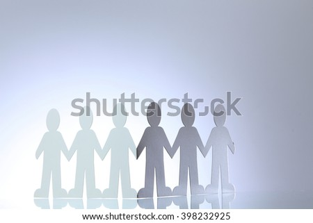 United people paper cut chain as crowd or teamwork abstract concept with white copy space