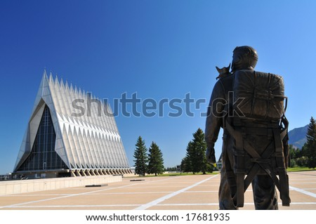 United States Air Force Academy Chapel with serviceman sculpture in the foreground and Cheyenne Mountain in background - stock photo