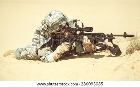 United States airborne infantry marksman in action