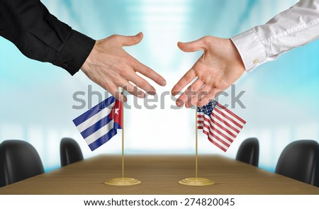 United States and Cuba diplomats agreeing on a deal - stock photo