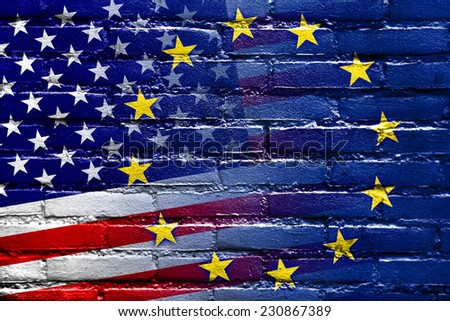 United States and European Union Flag painted on brick wall - stock photo