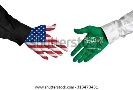 United States and Saudi Arabia leaders shaking hands on a deal agreement - stock photo