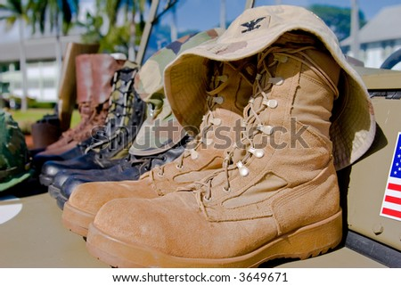 United States army military combat boots with hat - stock photo