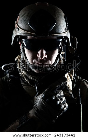 United States Army ranger with pistol on dark background - stock photo