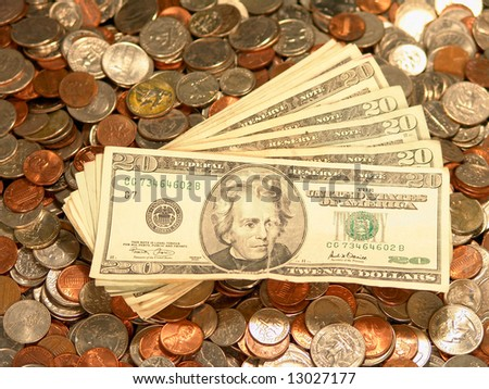 United States Bills Coins Dimes Pennies Quarters money background - stock photo
