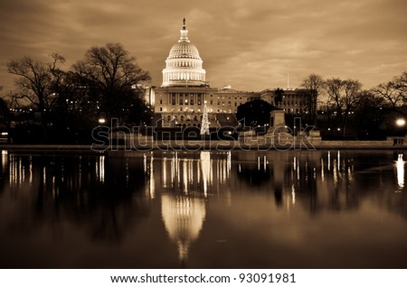 United States Capitol Building and mirror reflection on pool in sepia tones - stock photo