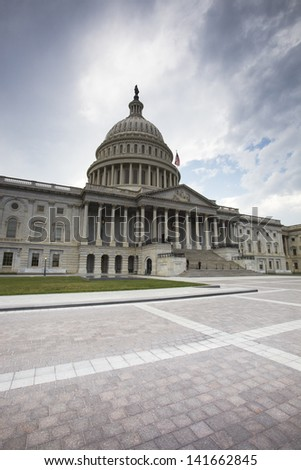 United States Capitol Building in Washington DC with American - stock photo