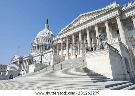 United States Capitol building Washington DC USA scenic view with entrance staircase under clear blue sky - stock photo