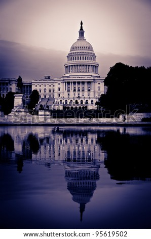 United States Capitol Building with mirror reflection in water - Washington DC - Split tone effect - stock photo