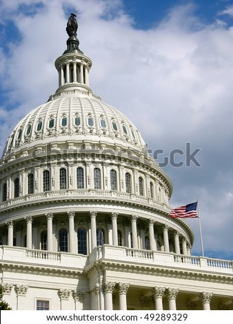United States Capitol Dome with USA flag flying.