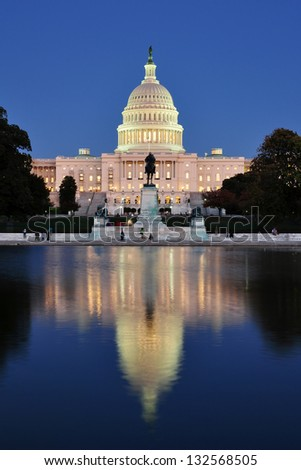 United States Capitol from the reflecting pool at dusk in Washington DC, USA. - stock photo