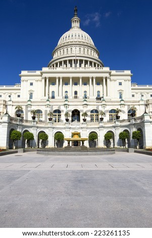 United States Capitol, Government in Washington, D.C., United States of America. Blue Sky behind.  - stock photo