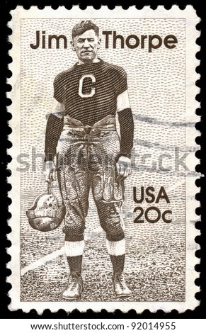 UNITED STATES - CIRCA 1984: A 20 cents stamp printed in the United States shows Indian Sports Athlete Jim Thorpe (1888-1953), circa 1984 - stock photo