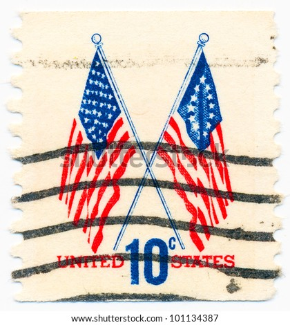 UNITED STATES - CIRCA 1973: A postage stamp printed in the United States, features waving US flag, circa 1973