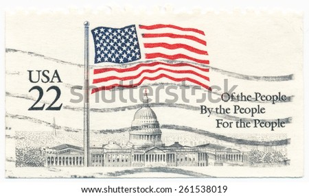 UNITED STATES - CIRCA 1985: A postage stamp printed in the United States, features waving US flag and Capitol Washington, circa 1985 - stock photo
