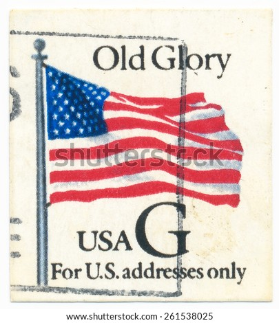 "UNITED STATES - CIRCA 1994: A postage stamp printed in the United States, features waving US flag, ""Old, Glory"" for U.S. addresses only, circa 1994 - stock photo"
