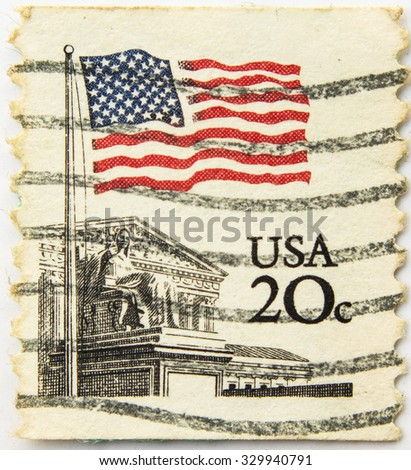 UNITED STATES - CIRCA 1981: A postage stamp printed in the United States, features waving US flag, circa 1981 - stock photo