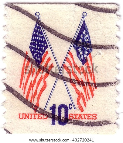 UNITED STATES - CIRCA 1973: A postage stamp printed in the United States, features waving US flag, circa 1973 - stock photo