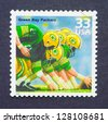 UNITED STATES � CIRCA 1999: a postage stamp printed in USA celebrating the five National Football League that Green Bay Packers won in the sixties, circa 1999. - stock photo