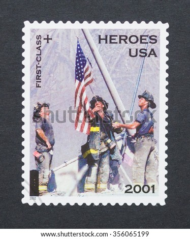 UNITED STATES - CIRCA 2002: a postage stamp printed in USA  commemorative of the of the heroes of September 11 of 2001, circa 2002. - stock photo