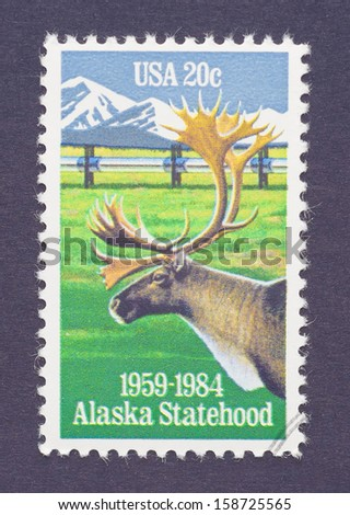 UNITED STATES - CIRCA 1984: a postage stamp printed in USA commemorative of the 25th anniversary of Alaskan statehood with an image of a caribou, circa 1984.