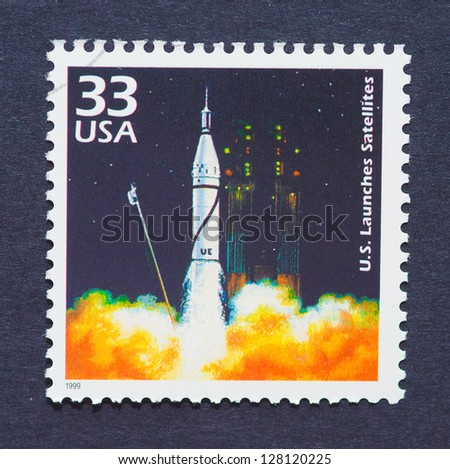 UNITED STATES � CIRCA 1999: a postage stamp printed in USA showing an image of a launching satellite, circa 1999. - stock photo