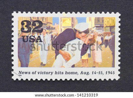 UNITED STATES - CIRCA 1995: a postage stamp printed in USA showing an image of a marine kissing a girl celebrating the end of the Second World War, circa 1995. - stock photo