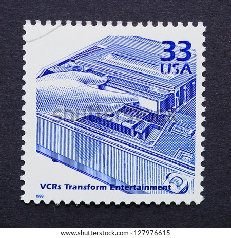 UNITED STATES � CIRCA 1999: a postage stamp printed in USA showing an image of an eighties videocassette recorder, circa 1999. - stock photo