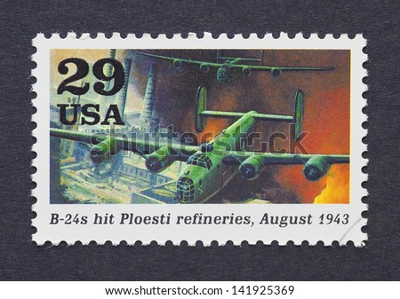 UNITED STATES - CIRCA 1995: a postage stamp printed in USA showing an image of B-24 plane bombing the Ploesti refineries in the Second World War, circa 1995.