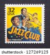 UNITED STATES - CIRCA 1998: a postage stamp printed in USA showing an image of jazz musicians playing in a club, circa 1998. - stock photo
