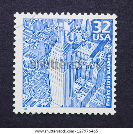 UNITED STATES � CIRCA 1998: a postage stamp printed in USA showing an image of the Empire State Building, circa 1998. - stock photo