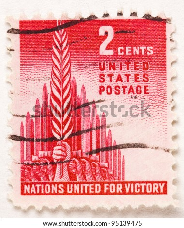 UNITED STATES - CIRCA 1943: A stamp printed in United States, displays Nations United For Victory, a hand holding a sheaf of grain in front of a phalanx of swords. United States - circa 1943
