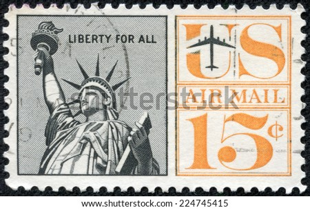 UNITED STATES - CIRCA 1961: A United States Airmail Postage Stamp depicting an image of the Statue of Liberty, circa 1961. - stock photo