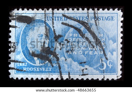 "UNITED STATES - CIRCA 1945: Depicting inset of Roosevelt + world, with inscription ""Freedom of Speech and Religion from want and Fear"" and ""1882 Roosevelt 1945"", color blue,  value 5 cents, circa 1945"