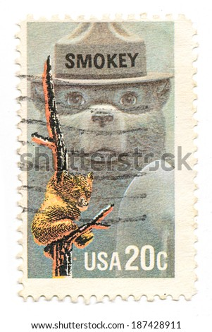 UNITED STATES - CIRCA 1984: Postage stamp printed in USA commemorating the 40th anniversary of  the US Forest Service mascot, Smokey The Bear. circa 1984. - stock photo