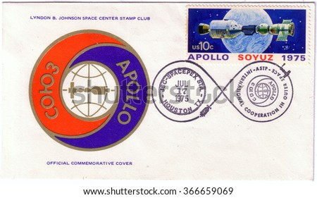 UNITED STATES - CIRCA 1975: postal stamp printed in USA shows the Apollo Soyuz test project, with a first day issued stamp, circa 1975. - stock photo