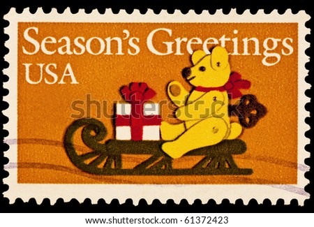 UNITED STATES - CIRCA 1980's : A stamp printed in United States. Teddy Bear on Sled Christmas Issue. United States - CIRCA 1980's - stock photo