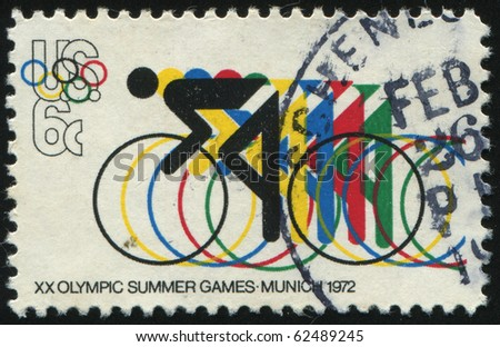 UNITED STATES - CIRCA 1972: stamp printed by United states, shows Bicycling and Olympic Rings, circa 1972. - stock photo
