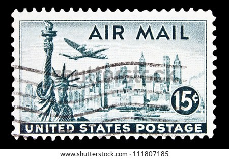 "UNITED STATES - CIRCA 1947: stamp printed in United states (USA) shows a plane, Statue of Liberty and New York Skyline with the inscription and name of series ""AIR MAIL"", circa 1947"