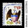 "UNITED STATES - CIRCA 1975: stamp printed in United states (USA), shows eagle and shield, with inscription ""One Nation Indivisible - E Pluribus Unum"", from the series ""Americana issue"" circa 1975 - stock photo"