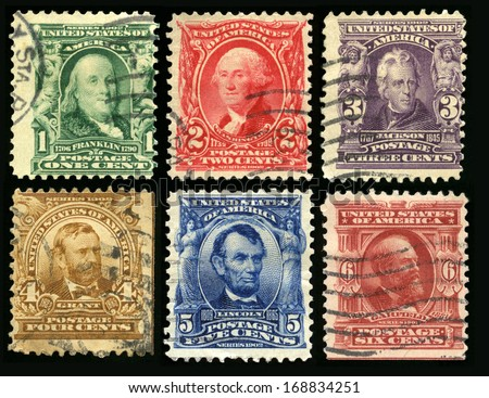 UNITED STATES - CIRCA 1902: Vintage US Postage Stamps each celebrating either a founding father, senator or US President (Franklin, Washington, Jackson, Grant, Lincoln and Garfield), circa 1902. - stock photo