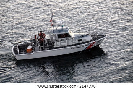 United States Coast Guard patrol boat with armed soldiers on new england coast - stock photo