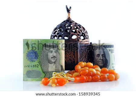 United States currency with Bahraini currency on an isolated background - stock photo
