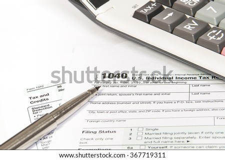 United States federal income tax return IRS 1040 documents - stock photo
