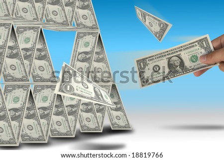 United States financial crisis metaphor. A hand subtracting dollars from a money pyramid. - stock photo