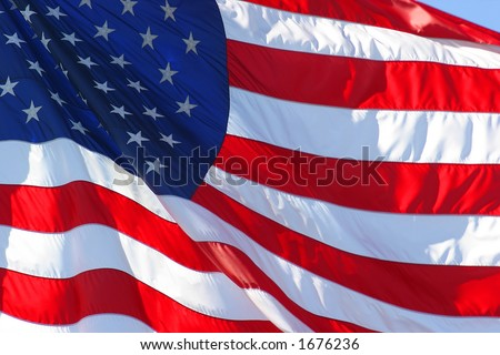 United States flag flapping in the wind - stock photo